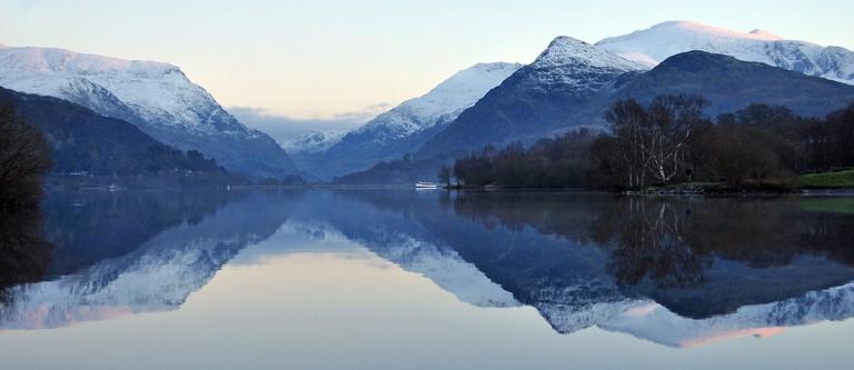 Snowdonia reflecting in Llanberis Lake at sunset