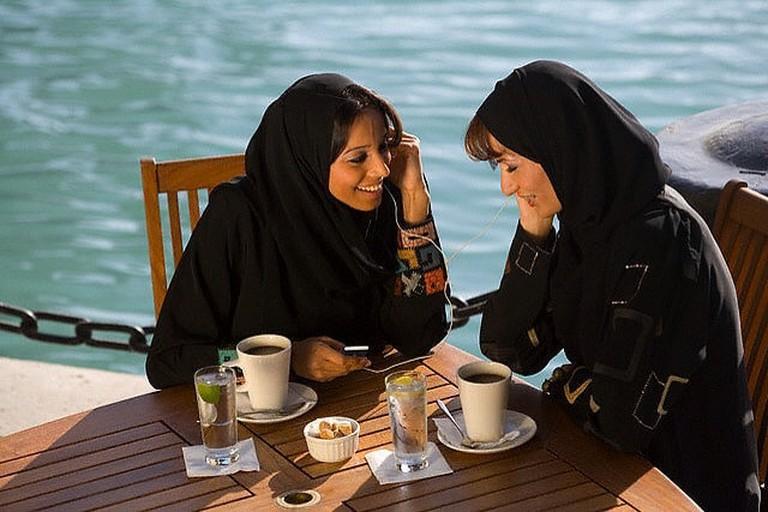 Local Emirati women enjoying a coffee break