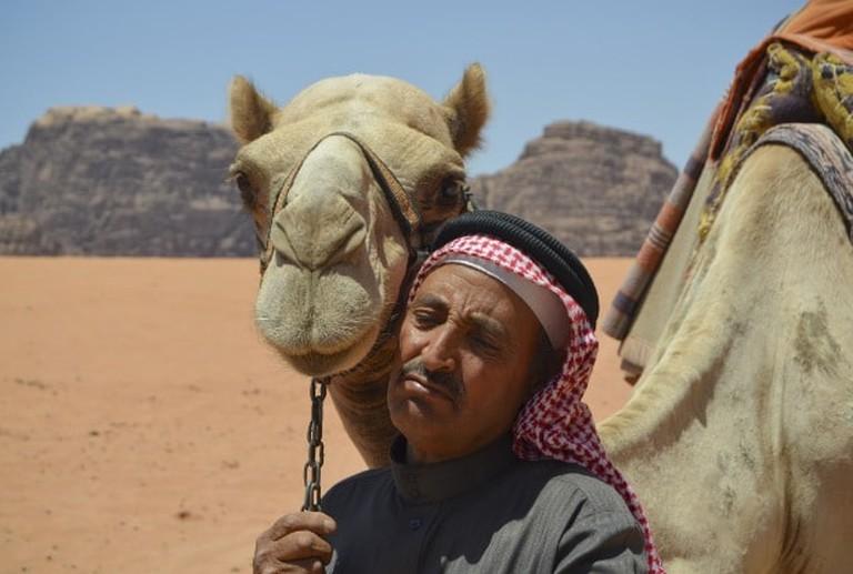 Emirati man with his camel