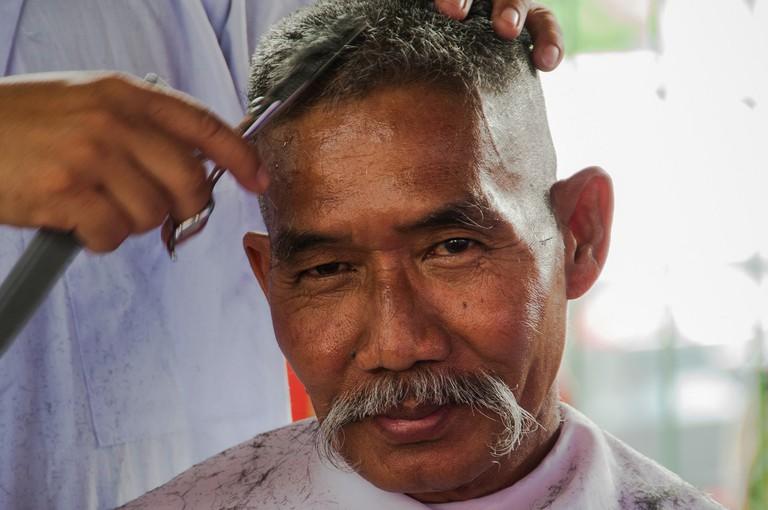 A man getting his hair cut