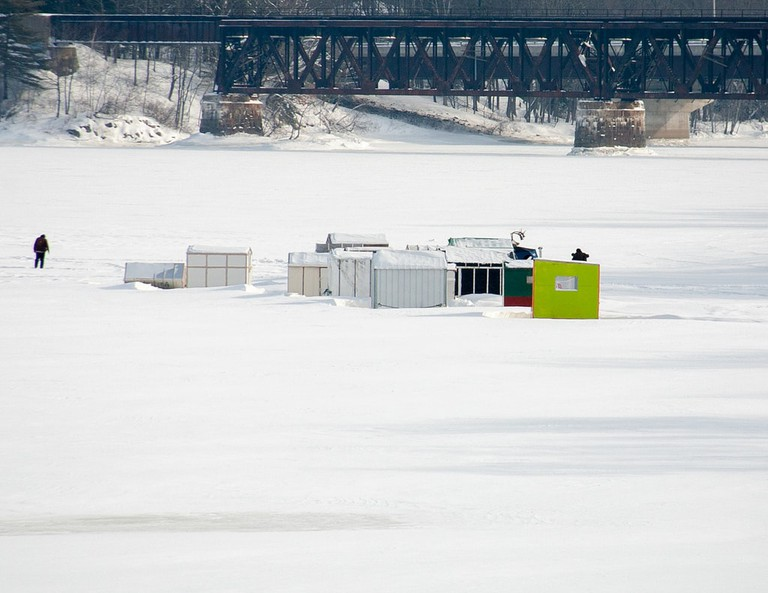 Ice fishing huts on the Androscoggin River, Maine