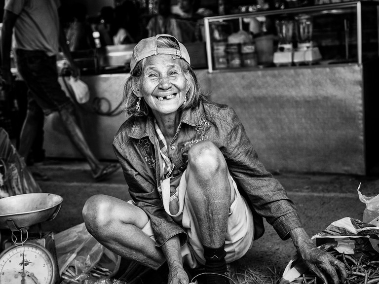 Old lady at the market smiling