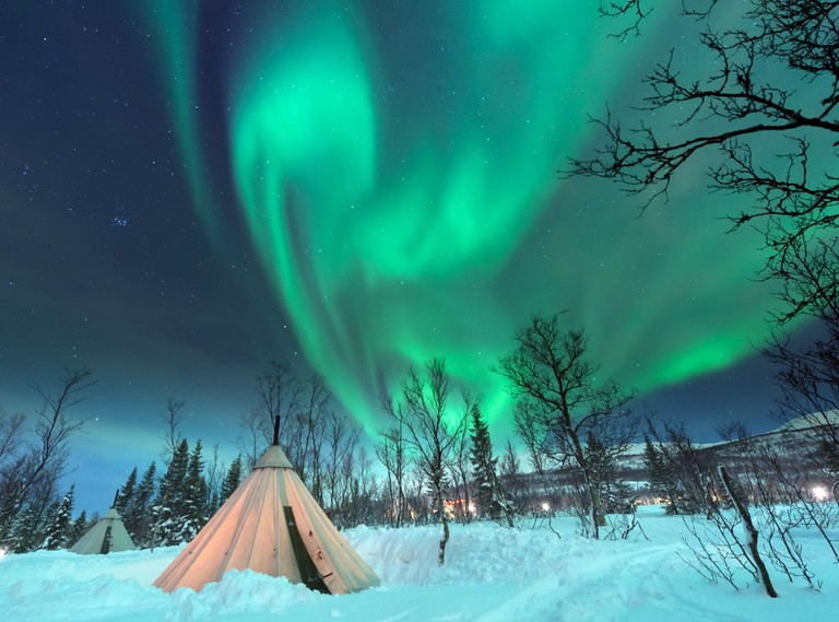 Stare at the northern lights while caring for reindeer with the Sami of Norway