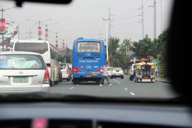 Driving along a Manila street