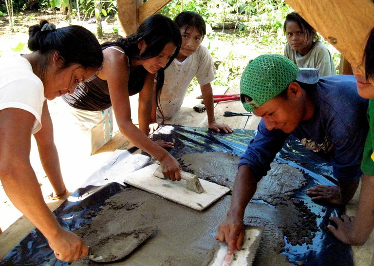 Achuar community members working cement