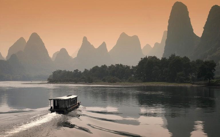 Limestone Karst Skyline over Li River at Dusk in Guilin, China