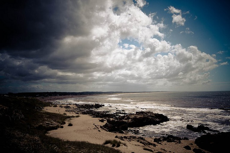 Storm approaching with beach and rocks, Uruguay
