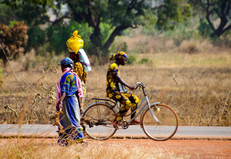 Lady on a bicycle, Tamale