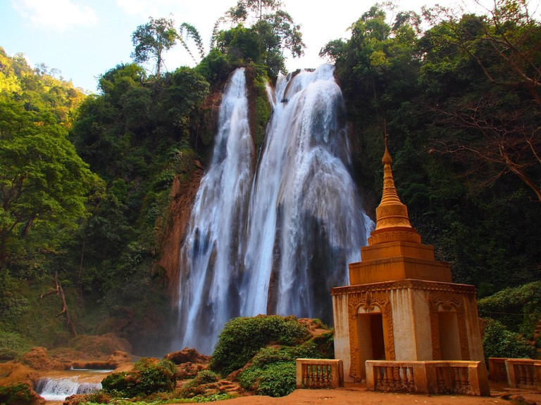A Buddhist temple sits at the foot of Anisakan Falls near Pyin Oo Lwin, Myanmar