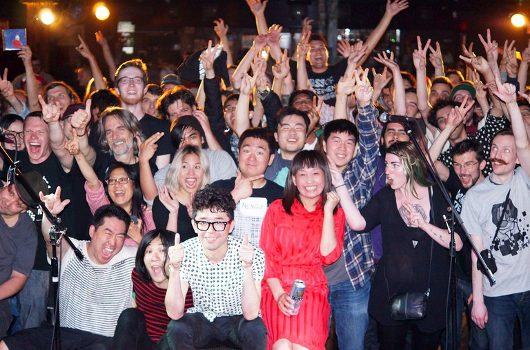 NMFT audience poses with the band at Biltmore Cabaret in Vancouver; Tanaka on the bottom left