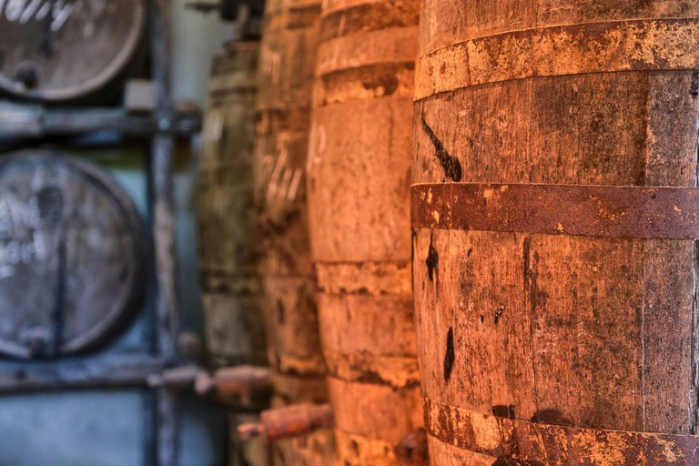 Cachaça Maria Izabel aging in wooden barrels