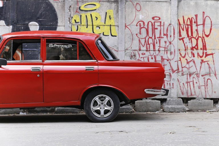 Graffiti and old cars in Cuba