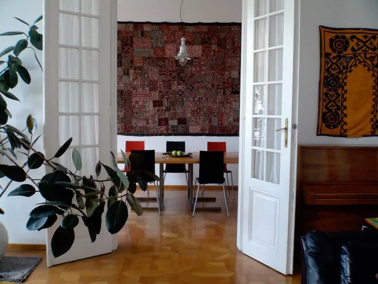 Beautiful floors and tall ceilings are part of this beautiful Vienna Airbnb