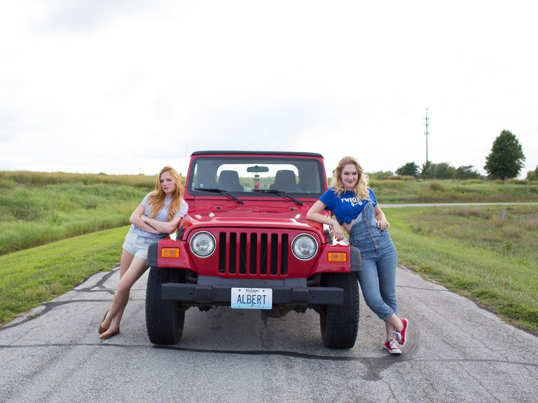 Millie (Emma Bell), Albert the Jeep, and Emma (Hope Lauren)