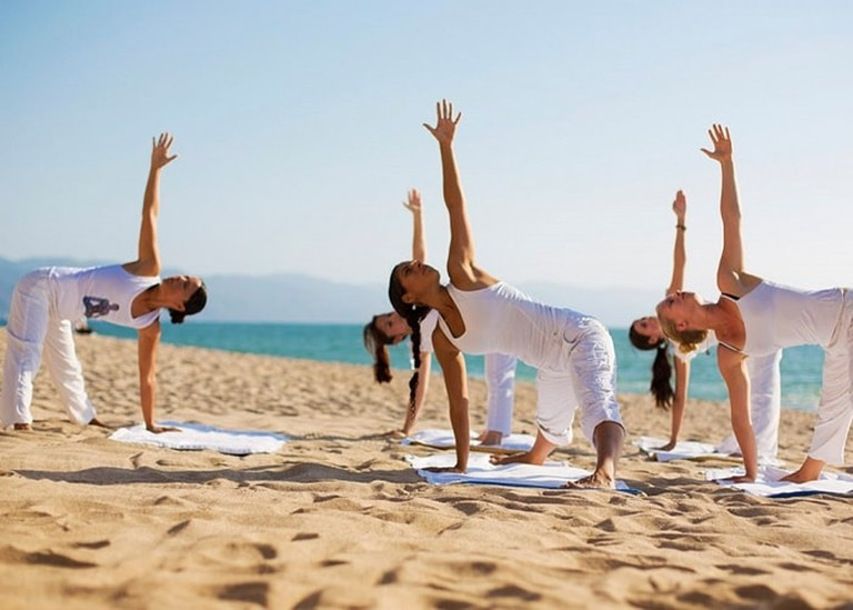 Yoga on the beach | Courtesy of Sailing Yoga Experience