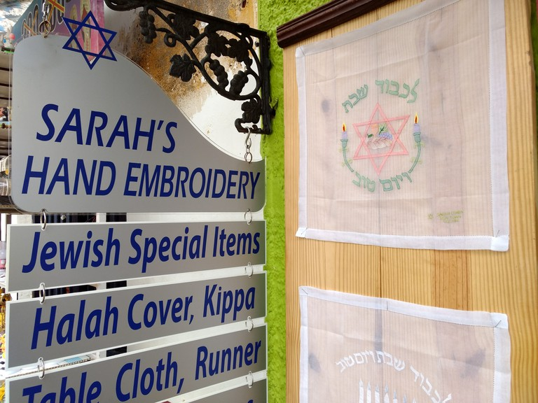 Sarah Aunty's home is part shop that still sells hand stitched items