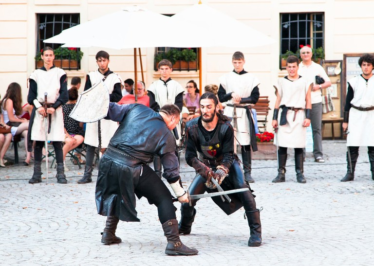 Knights engage in a swordfight