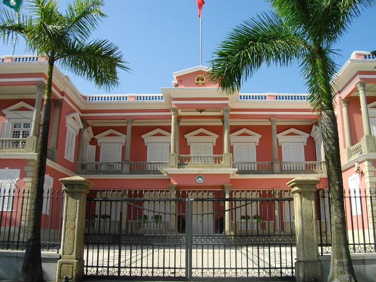 Portuguese influence is represented by colonial style buildings like the Macau Government Headquarters