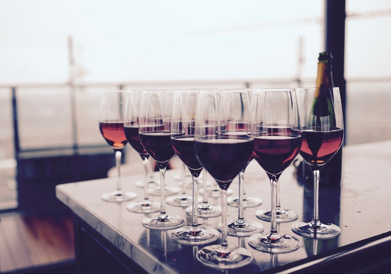 Wine Glass With Red Liquid on Black Table (c) Pexels