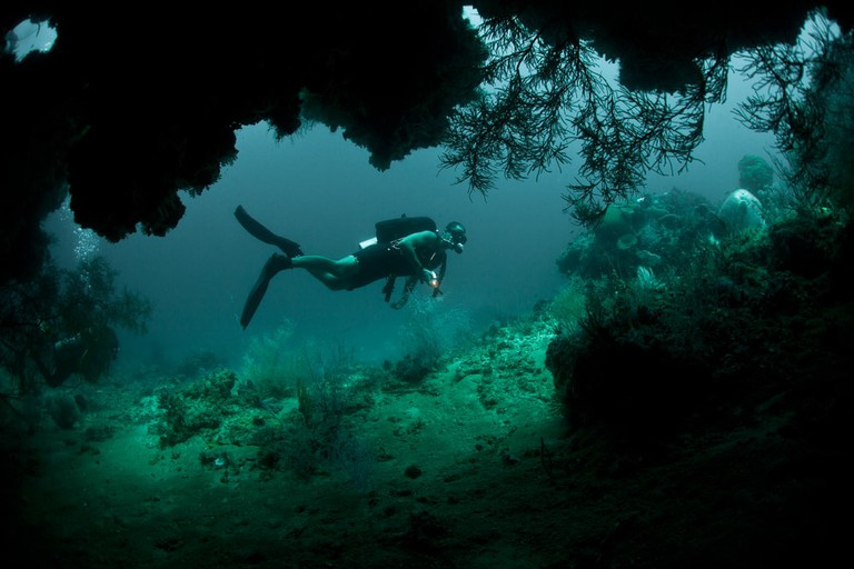 Diving in the mouth of a cave in Raja Ampat