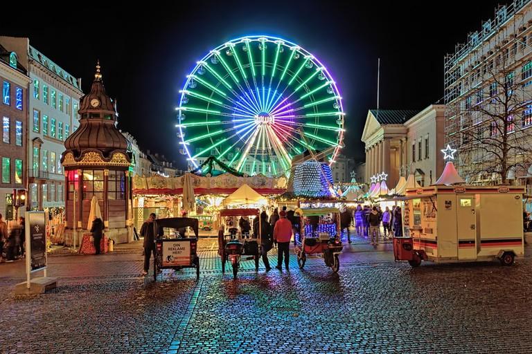 Christmas market with Ferris wheel on the Nytorv square in evening | Mikhail Markovskiy/Shutterstock