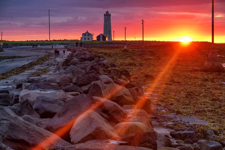 Lighthouse at Sunset, Grotta, Iceland   © Simon Lukas/Shutterstock