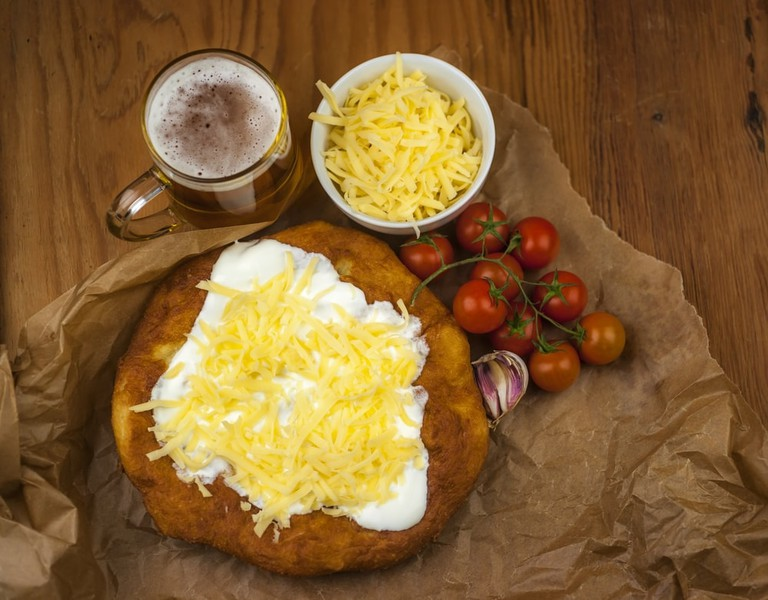 This deep fried bread is served with sour cream and cheese