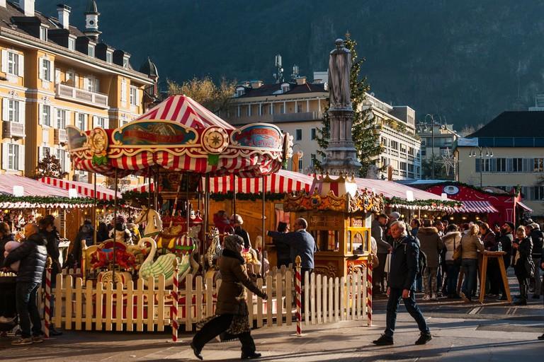Bolzano Christmas market set against the backdrop of the Italian Alps | © Simone Padovani/Shutterstock