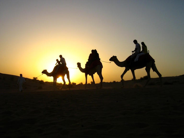 Riding a camel in the desert is a must