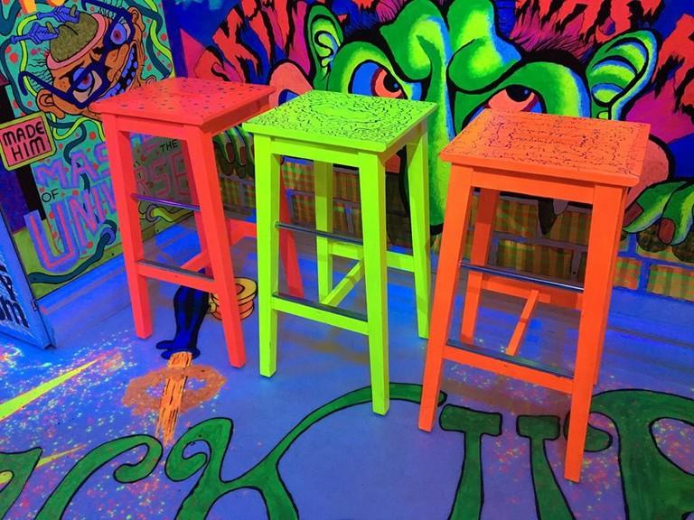 Uncomfortable stools at Misfornøyelsesbar | Courtesy of Misfornøyelsesbar