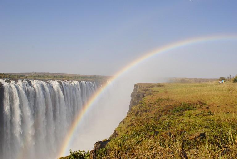 A rainbow descending over Victoria Falls