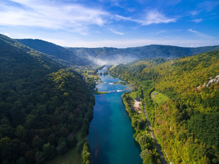 Aerial view of Una river surrounded by forest and hills, Bosnia and Herzegovina   © paul prescott/Shutterstock