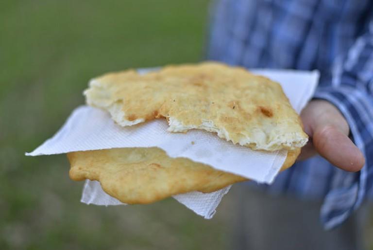 Someone holding a torta frita