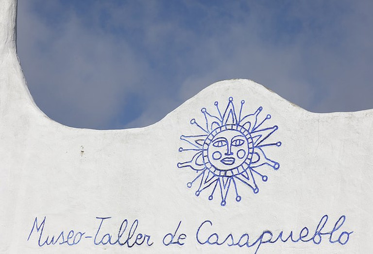 A wall of Casapueblo with the 'Sun of May'.