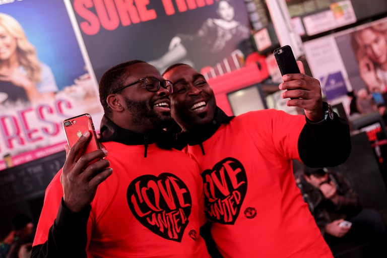 Manchester United legends Louis Saha (left) and Andy Cole in Times Square