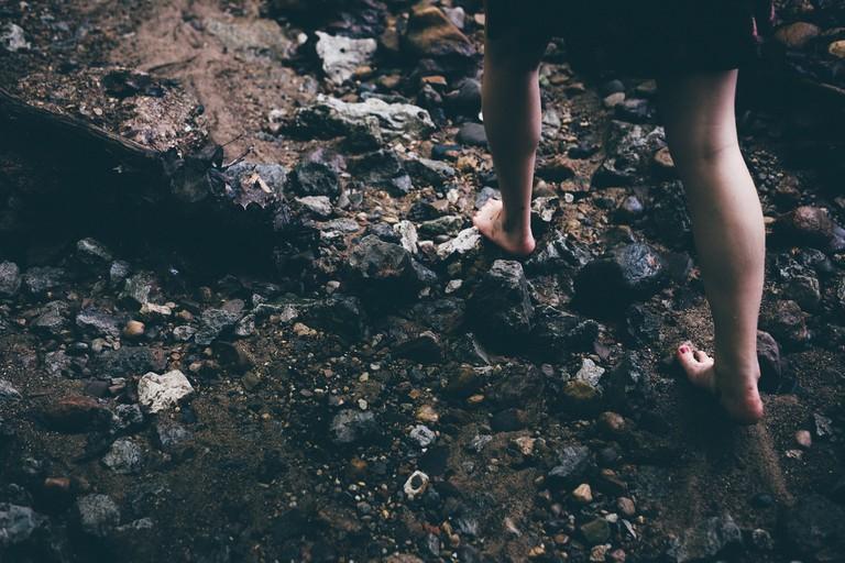 Walking barefoot over rocks
