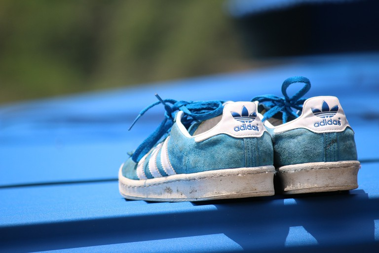 A pair of blue Adidas shoes