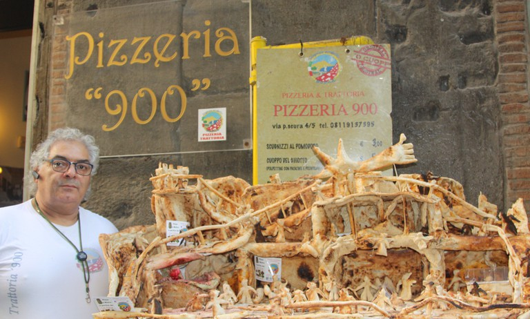 Pizza maker and artist Carmine Mauro in front of his pizza nativity.