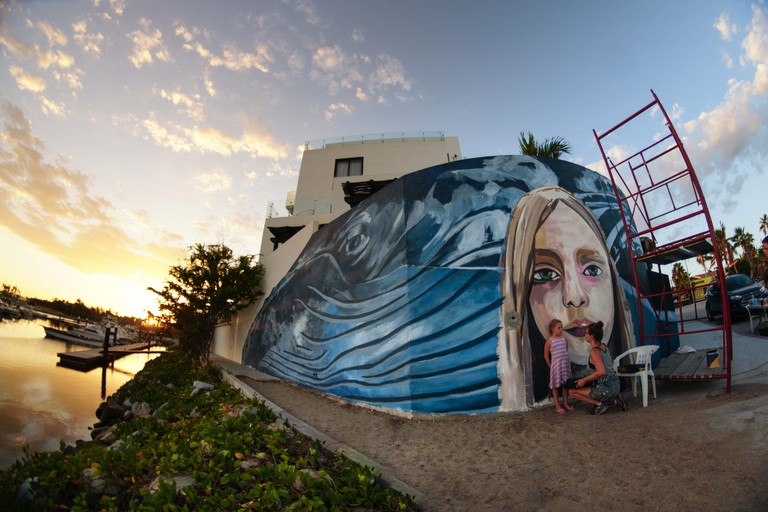'We Are Watching You', a mural by Paola Beck | © El Ganzo