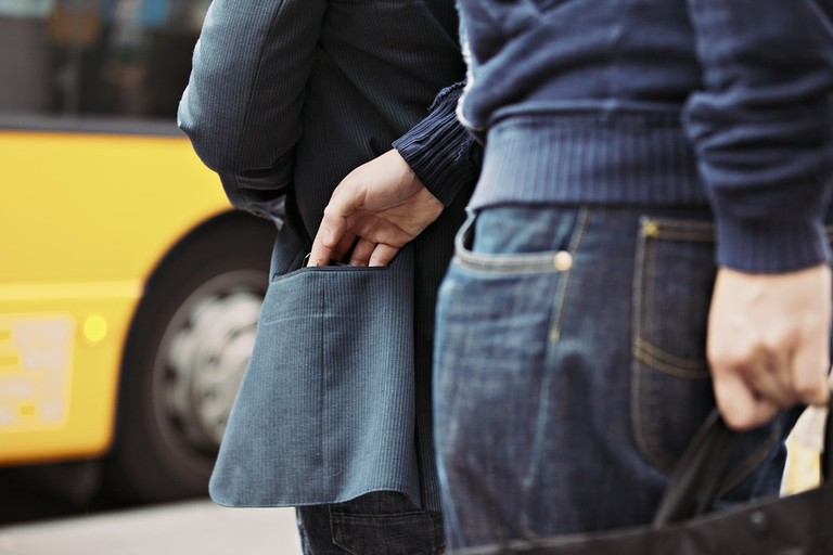 Pickpocket in the act | ©Jacob Lund/Shutterstock