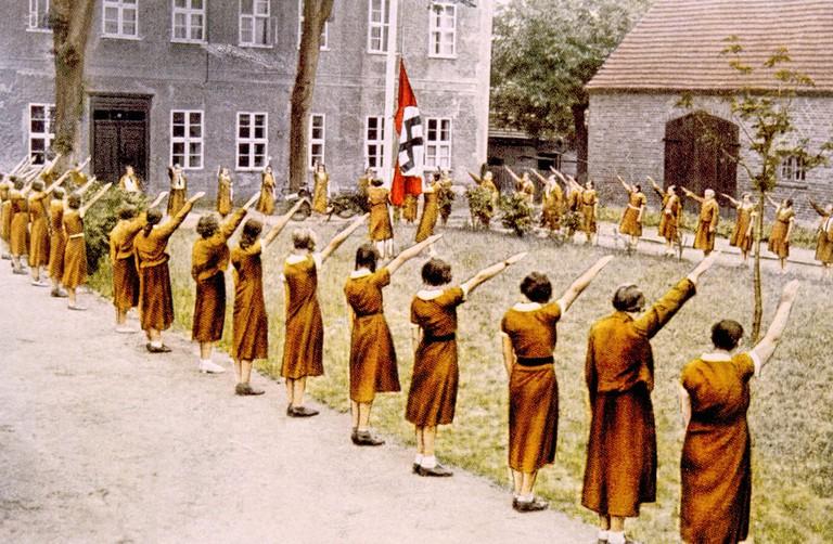 Illustration of girls showing the Nazi salute