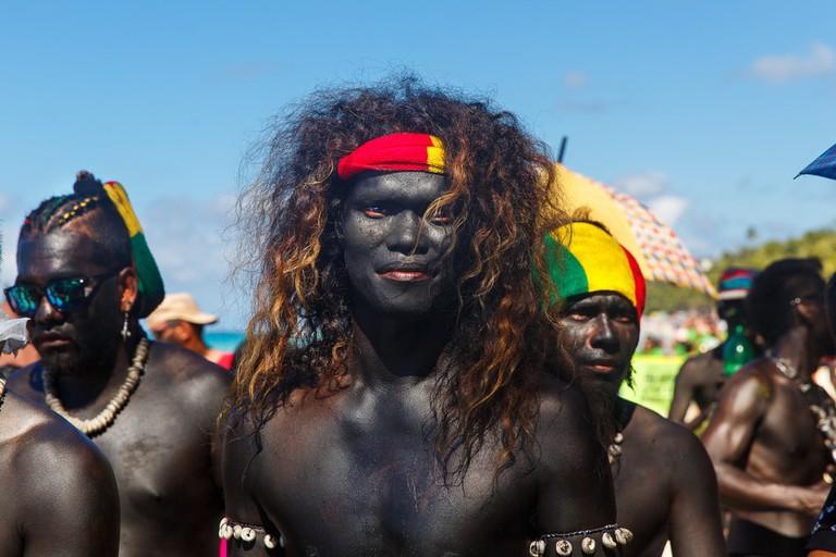 Men with darkened faces at Ati-Atihan in Boracay
