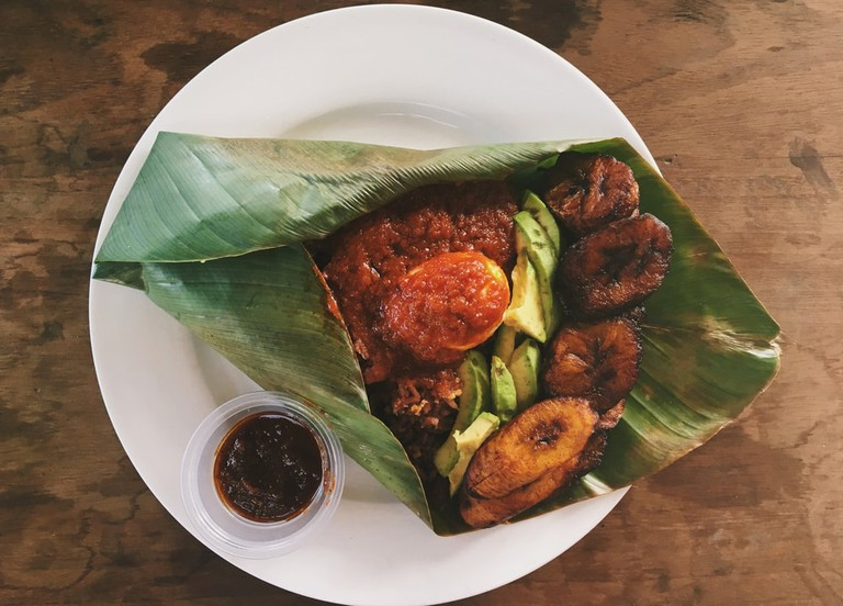 Ghanaian waakye served in a banana leaf