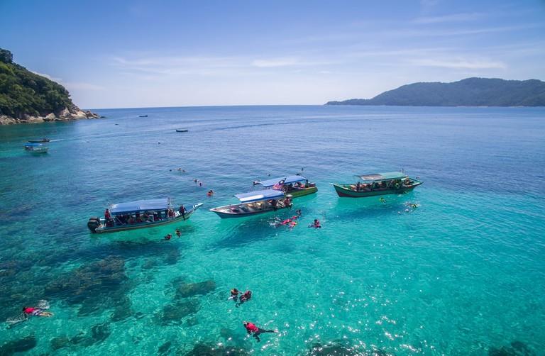 Snorkeling in clear waters of Perhentian Island