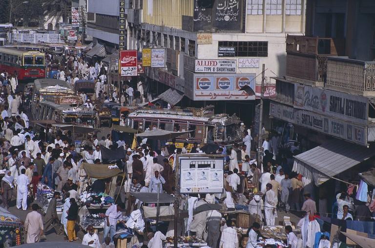 1200px-People_in_Karachi,_1990