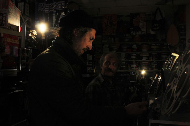 Liam Saint-Pierre and Umit Mesut check a film reel   © Alessandra McAllister