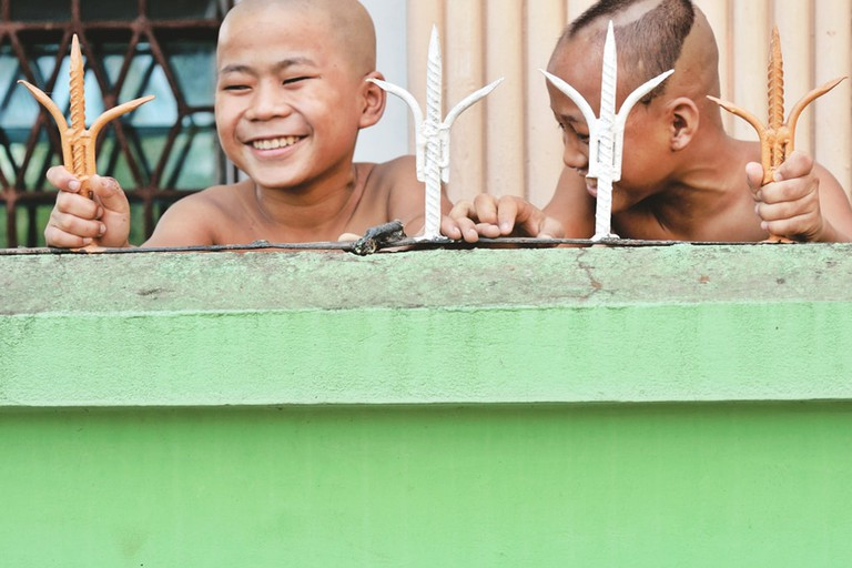 Novice-Monks-Having-Heads-Shaved