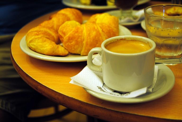 A typical merienda of coffee and medialunas