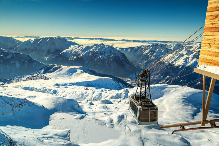 Spectacular ski resort with cable car station on the Pic Blanc peak in the French Alps, Alpe d'Huez, France   © Gaspar Janos / Shutterstock