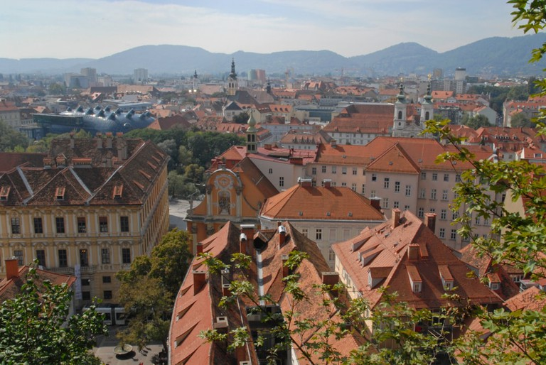 Red roofs in Graz, Mariahilfer church and Kunsthaus   © Alexander Jung/Shutterstock